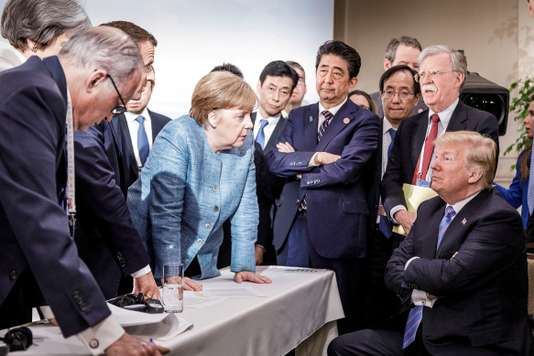 German Chancellor Angela Merkel speaks to U.S. President Donald Trump during the second day of the G7 meeting in Charlevoix city of La Malbaie, Quebec, Canada, June 9, 2018. Bundesregierung/Jesco Denzel/Handout via REUTERS  ATTENTION EDITORS - THIS IMAGE WAS PROVIDED BY A THIRD PARTY. NO RESALES. NO ARCHIVES.     TPX IMAGES OF THE DAY