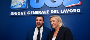 "Italy's Interior Minister, Matteo Salvini (L) and leader of France's far-right National Rally (RN) party, Marine Le Pen pose prior to attending a debate on the theme ""Economic growth and social prospects in a Europe of Nations"" on October 8, 2018 at the headquarters of the Unione Generale del Lavoro (UGL, General Union of Labor) trade union in Rome. (Photo by Alberto PIZZOLI / AFP)"